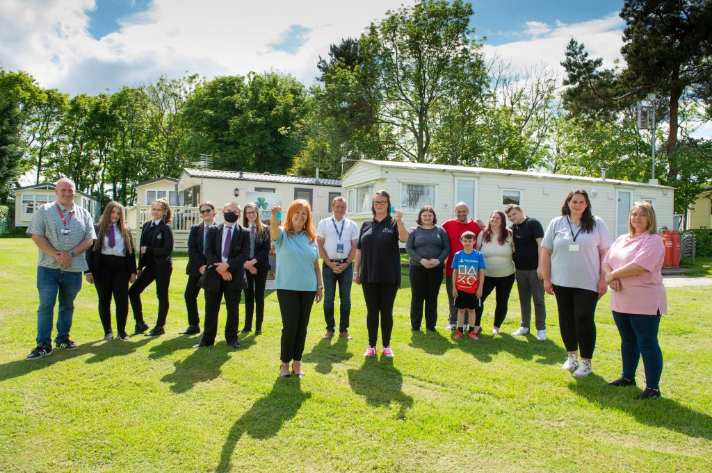 Young carers on Teesside receive keys to two caravans from Frances Connolly a...